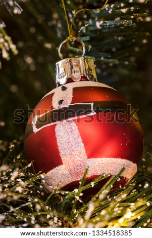 Christmas lights, baubles, stars and other seasonal decorations on a snow frosted xmas tree #1334518385