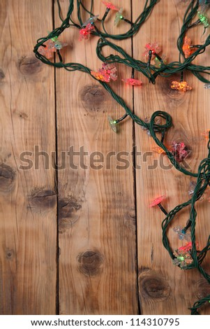 Christmas lights on a wooden background with copy space. Decorative garland