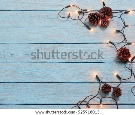 christmas lights on blue wooden background