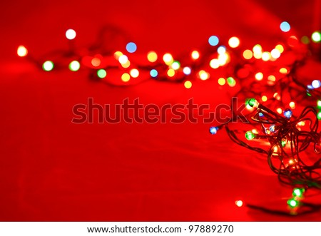 Christmas lights on red background, shallow focus