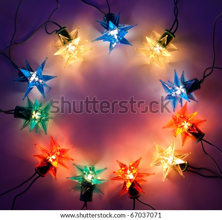 Christmas lights round frame on dark background with copy space.Decorative garland
