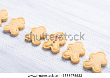 Christmas little men from cookies lie on a gray background from corner to corner diagonally #1586476633