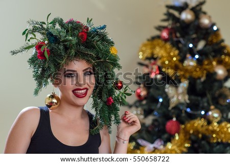 christmas makeup winter fashion woman beautiful new year and christmas tree holiday hairstyle