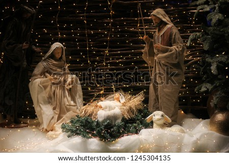 Christmas Manger scene with figures including Jesus, Mary, Joseph, sheep and magi. #1245304135