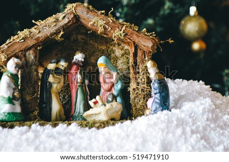 christmas manger scene with figurines including jesus mary joseph sheep and magi