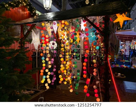 Christmas market in Altona district, shop with christmas decoration, garlands and gifts. Festive Christmas market in the evening.