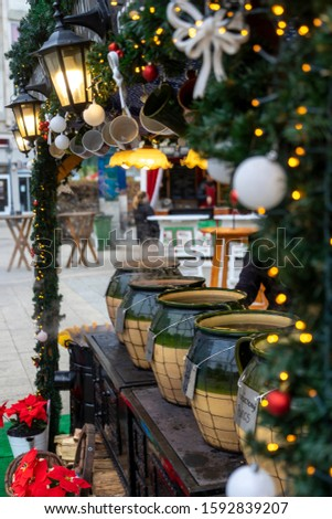 Christmas market in Europe. Debrecen, Hungary. In the photo there is an inscription in Hungarian 'Karácsonyi puncs' which means - 'Christmas punch' Stock fotó ©