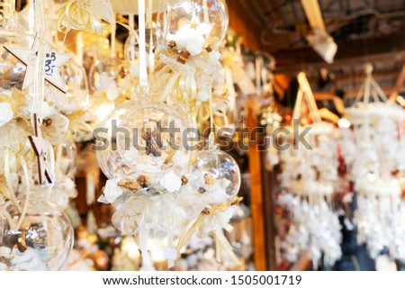 Christmas market kiosk details with hanging christmas tree decorations with decorations