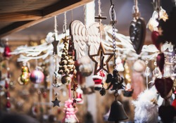 Christmas market stall with handcrafted wooden christmas decorations. Traditional Christmas fair in Europe