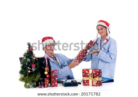 Christmas, medical team, two young male and female cardiologist in the office.  Studio, white background.