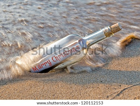 christmas message in a bottle on the beach