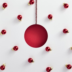 Christmas minimal concept - abstract red christmas bauble with xmas balls. Abstract background. Retro background. Xmas decoration bauble.