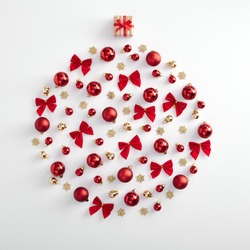 Christmas minimal concept - bauble silhouette made from red xmas ball, bow and gold snowflake on white background. Square composition. Flat lay, top view. Red, gold and white layout