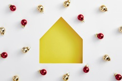 Christmas minimal concept - christmas house yellow silhouette with bauble pattern. Flat lat, top view. Merry christmas (xmas) background. Minimal idea concept. Simple shape.