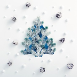 Christmas minimal concept - Xmas tree shape made of snowy fir branch with snowfall and pine cone pattern. Square composition, flat lay, view from above. Winter spruce concept