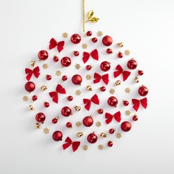 Christmas minimal mockup - abstract bauble made from red xmas ball, bow and gold snowflake on white background. Square composition. Flat lay, top view. Red, gold and white layout