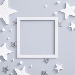 Christmas minimal mockup - monochrome layout with white and silver star. Square composition, flat lay, top view. White paper frame with copy space. Xmas celebration. Xmas winter holiday concept.