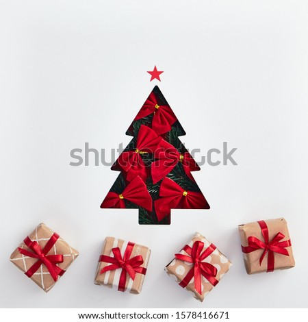 Christmas minimalist concept - creative christmas tree made of red bow. Square layout with xmas gift. Xmas winter holiday concept. Template design. White background. Minimal, art. #1578416671