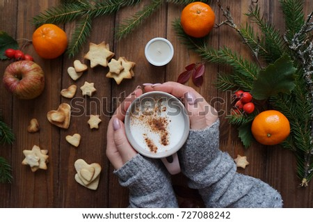Christmas mood tree rope Mandarin oranges on wooden background a Cup of hot coffee, the sweet comfort of homemade biscuits of homemade biscuits #727088242