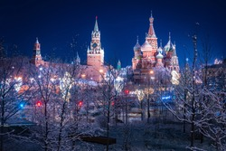 Christmas Moscow. New year in the capital of Russia. Christmas evening in the center of Moscow. Kremlin and St. Basil Cathedral on the background of a winter landscape. New year celebration in Russia