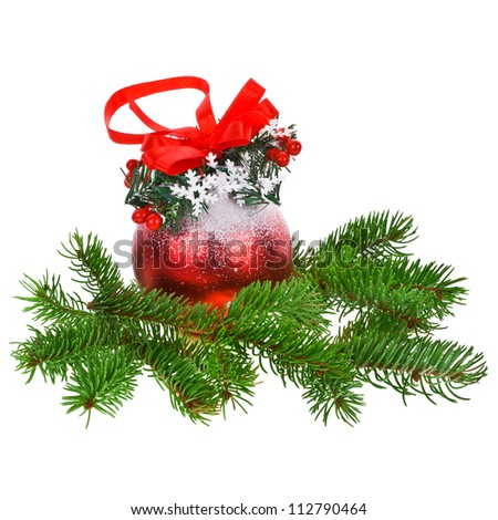 Christmas motifs - branch of a Christmas tree with big red decorated ball   isolated on white background