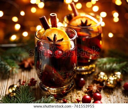 Christmas mulled red wine with spices and fruits on a wooden rustic table. Traditional hot drink at Christmas time Stockfoto ©