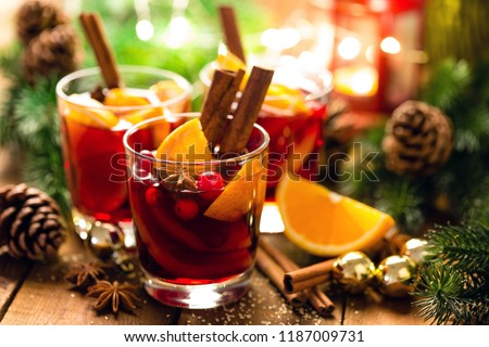 Christmas mulled red wine with spices and oranges on a wooden rustic table. Traditional hot drink at Christmas #1187009731