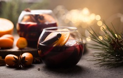 Christmas mulled wine  in circle glasses  with orange cinnamon star anise spices. Traditional hot drink in circle glasses or beverage, festive cocktail at X-mas or New Year