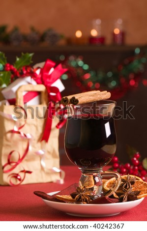 Christmas mulled wine with gift bag with presents in background