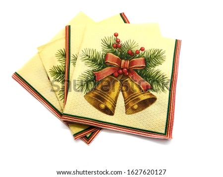 Christmas napkin isolated on white background. Composition of napkins for christmas. Paper napkin. Napkin with New Year's pattern.