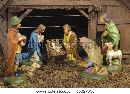 christmas nativity scene of jesus birth in an old cottage nearby bethlehem with joseph, mary and three shepherd