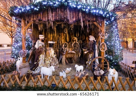 Christmas nativity scene with three wise men presenting gifts to baby