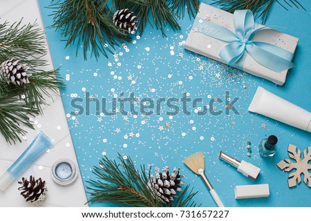 Shutterstock Christmas, New Year blue beauty flat lay frame. Cosmetics top view composition