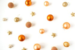 Christmas / New Year holiday composition. Colorful Christmas baubles / balls and stars on white background. Flat lay, top view festive concept.