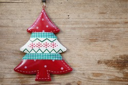 Christmas, New Year red and white fur tree decoration on wooden table. Top view