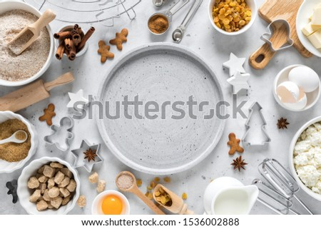 Christmas, New Year, X-mas, Noel or Xmas culinary background, baking recipe. Ingredients for cooking on kitchen table holiday festive pastry. Copy space #1536002888