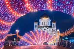 Christmas night in Moscow. Russia on a winter night. Temple of Christ Savior on a winter evening. Christmas decorations on the streets of capital. Sights of Moscow. New Year in Russia cities.