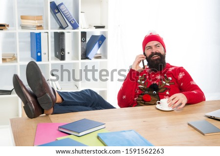 Christmas offer. Bearded man communicate with customer. Mobile phone communication. Business communication. Holiday season communication. Public relations. Marketing and communication.