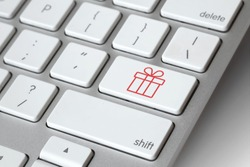 Christmas online shopping. Keyboard with gift symbol key - online Christmas present shopping concept. E-commerce concept. Computer, laptop. Shop online, buy now