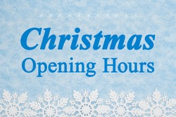 Christmas Opening Hours sign with white snowflakes on blue material