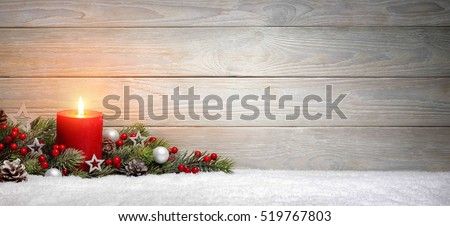 Christmas or Advent wood background with a burning candle on snow, decorated with fir branches and ornaments, panoramic format with copy space #519767803