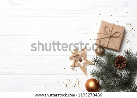 Christmas or New Year accessories on wooden background top view. Holidays, gifts, background, place for text. flatlay