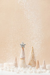 Christmas or New Year background decorated with Christmas tree of waffle cones and falling snow of sugar, festive sweets concept, copy space