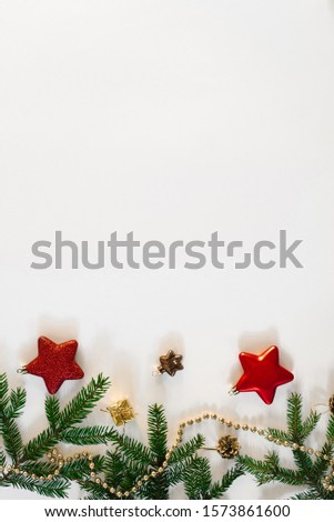 Christmas or new year background. Simple composition of Christmas tree decorations and fir branches, flat layer, empty space for greeting text, greeting card #1573861600