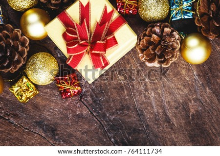 christmas or new year background with pine conesgift box on red ribbongolden ball of