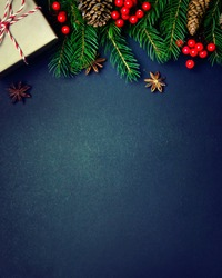 Christmas or New Year dark background, Xmas black board framed with season decorations, space for a text, view from above.