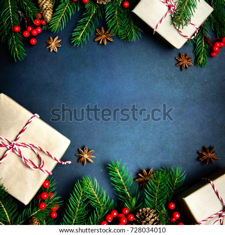 Christmas or New Year dark background, Xmas black board framed with season decorations, space for a text, view from above #728034010