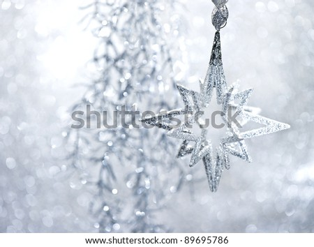 christmas or new year decoration. silver shiny star. abstract background