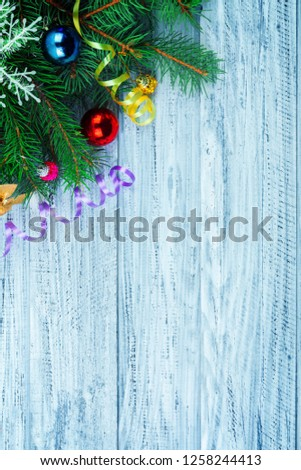 Christmas or new year flatlay design, fir-tree branch and holiday decorations on wooden background in left top corner,top view #1258244413