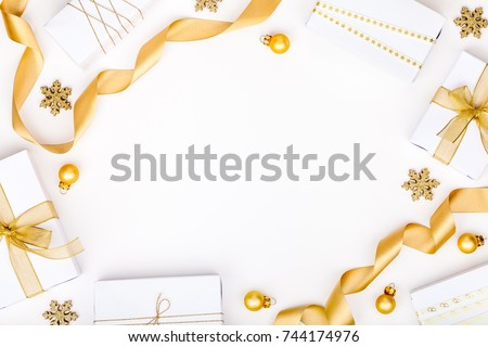 Stock Photo christmas or new year frame composition. christmas decorations in gold colors on white background with empty copy space for text. holiday and celebration concept for postcard or invitation. top view